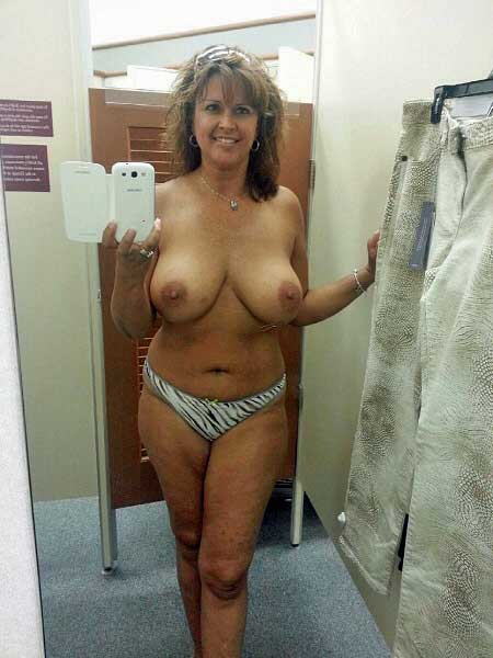 Mature Lady In Red In Bathroom 28